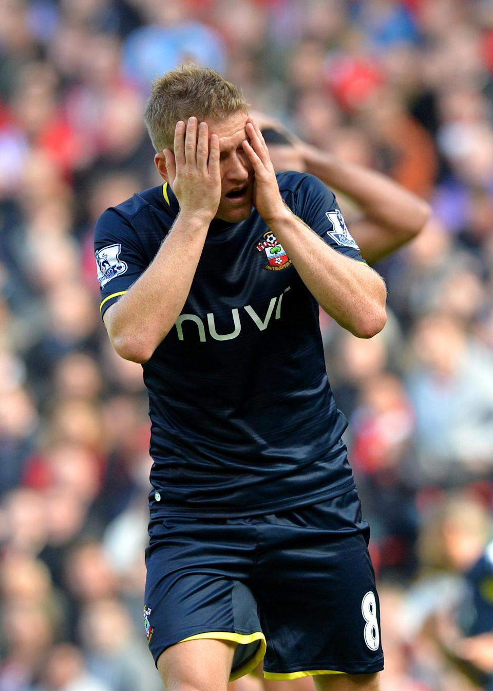 Southampton's Steven Davis reacts to missing a chance to score a goal during their English Premier League match against Liverpool, at Anfield stadium in Liverpool, northwest England, on August 17, 2014 (AFP Photo/Paul Ellis)