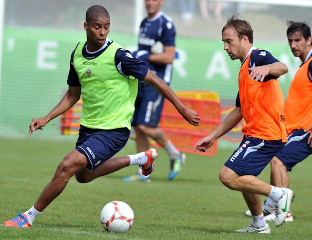 Lorient' s French midfielder Kevin Monnet-Paquet (L) vies with French defender Maxime Baca (R) a training session on August 7, 2012 at the Moustoir Stadium in Lorient, western France, prior the French Championship League 1 football matches beginning on August 10, 2012. FP PHOTO FRANK PERRYFRANK PERRY/AFP/GettyImages