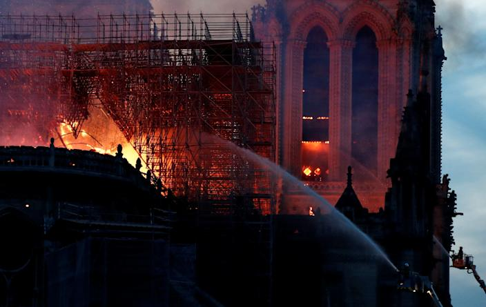 Fire fighters douse flames of the burning Notre Dame Cathedral in Paris, France April 15, 2019. (Photo: Benoit Tessier/Reuters)