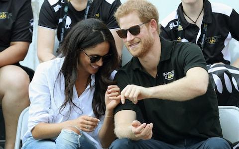 Prince Harry and Meghan Markle attend a Wheelchair Tennis match during the Invictus Games 2017 - Credit: Chris Jackson/Getty Images