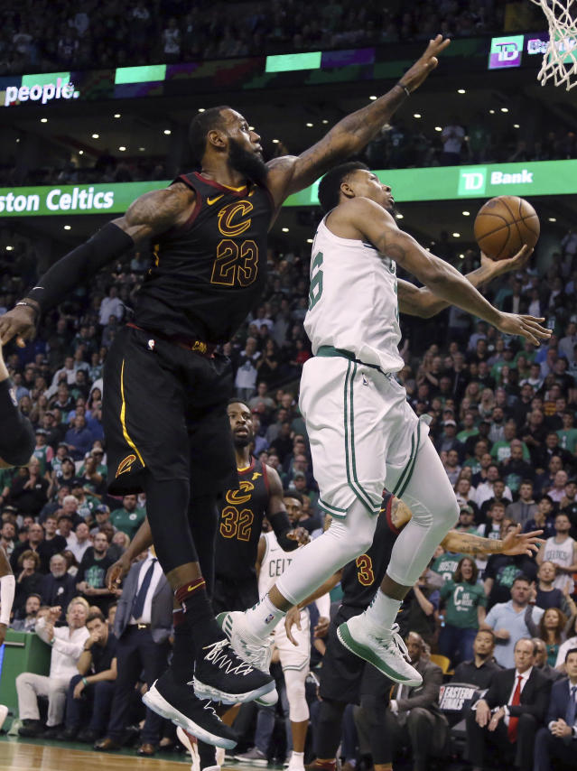 Boston Celtics guard Marcus Smart, right, drives against Cleveland Cavaliers forward LeBron James during the second half in Game 7 of the NBA basketball Eastern Conference finals, Sunday, May 27, 2018, in Boston. (AP Photo/Elise Amendola)