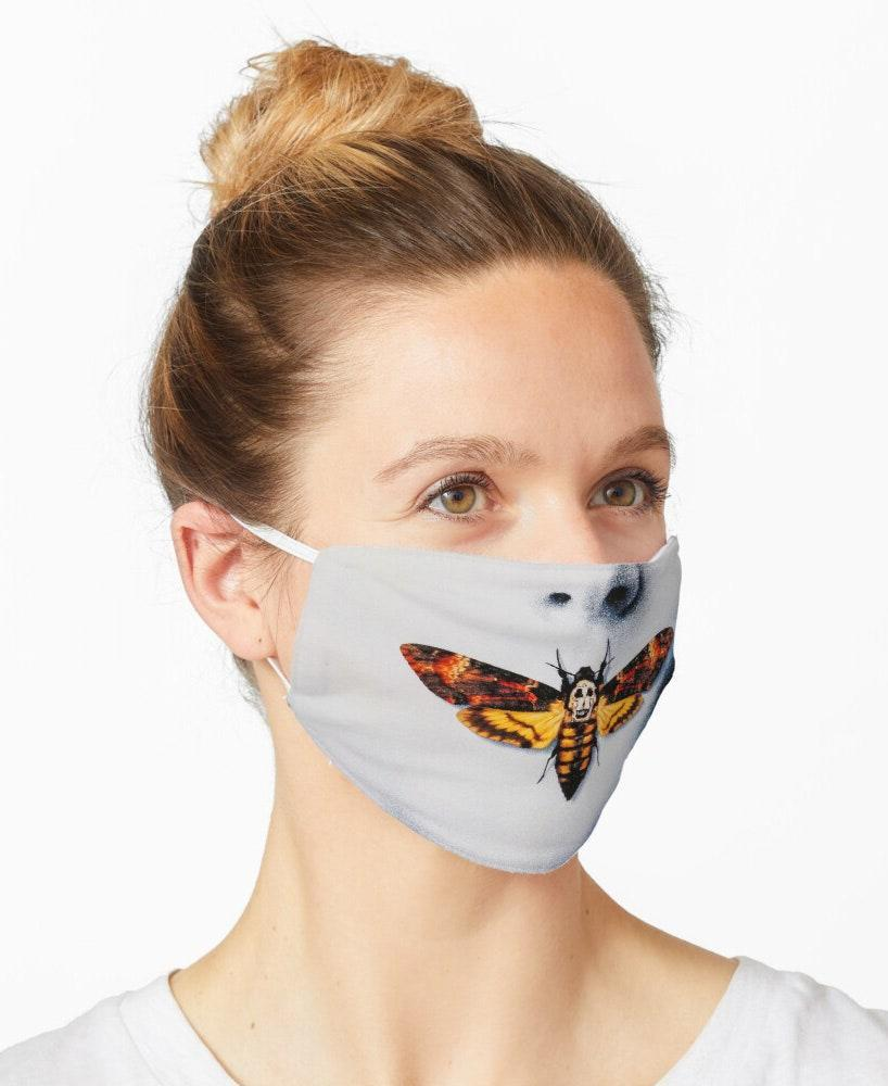 "Feeling freaked out just looking at this, to be honest. <em>Hello, Clarice</em>. $12, Redbubble. <a href=""https://www.redbubble.com/i/mask/Silence-of-the-lambs-by-rehabtiger/53637786.9G0D8"" rel=""nofollow noopener"" target=""_blank"" data-ylk=""slk:Get it now!"" class=""link rapid-noclick-resp"">Get it now!</a>"