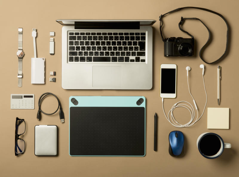 Is your desk filled with electronics? These accessories can help with that. (Photo: Getty)