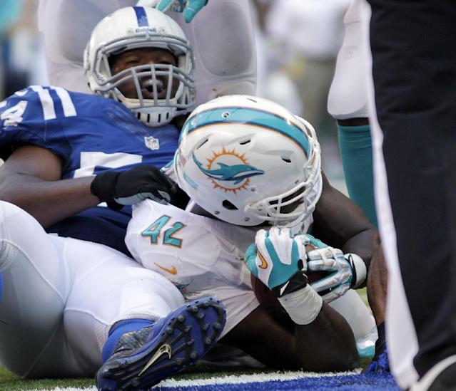 Miami Dolphins' Charles Clay (42) scores on a 1-yard touchdown run during the second half an NFL football game against the Indianapolis Colts Sunday, Sept. 15, 2013, in Indianapolis. (AP Photo/AJ Mast)