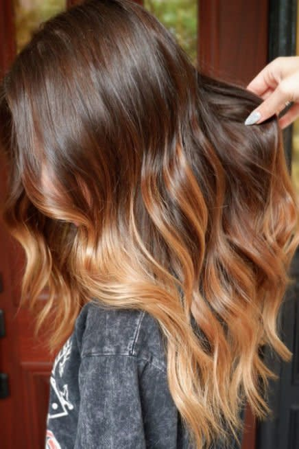 """<p>Our busy schedule (and wallet!) was happy to hear that fall is the perfect time to embrace the fade—color fade, that is. This honeyed caramel color by <a href=""""https://www.instagram.com/colour.jade/"""" target=""""_blank"""">stylist Jade Federico</a> is the ultimate autumn inspo. </p>"""