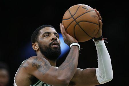 Mar 14, 2019; Boston, MA, USA; Boston Celtics guard Kyrie Irving (11) takes a free throw during the second half against the Sacramento Kings at TD Garden. Mandatory Credit: Greg M. Cooper-USA TODAY Sports