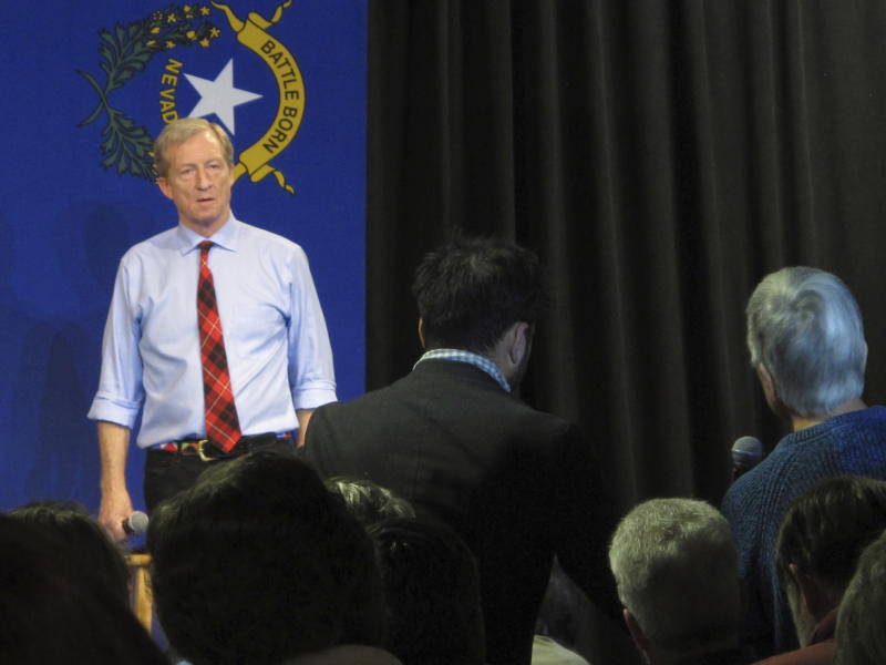"""In this Tuesday, Feb. 11, 2020, photo, Democratic presidential hopeful Tom Steyer listens to a question from one of the audience members at a town hall gathering at the National Automobile Museum in Reno, Nev. The California billionaire says his campaign is """"doing fine"""" despite dismal showings in Iowa and New Hampshire, but has to do """"very well"""" in the Nevada caucuses next up Feb. 22. (AP Photo/Scott Sonner)"""