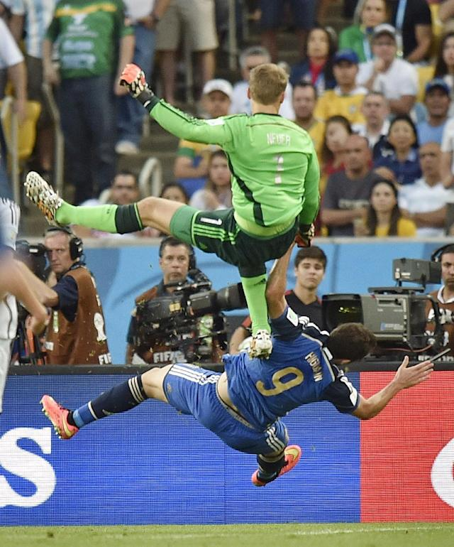 Germany's goalkeeper Manuel Neuer, top, clatters into Argentina's Gonzalo Higuain during the World Cup final soccer match between Germany and Argentina at the Maracana Stadium in Rio de Janeiro, Brazil, Sunday, July 13, 2014. (AP Photo/Martin Meissner)