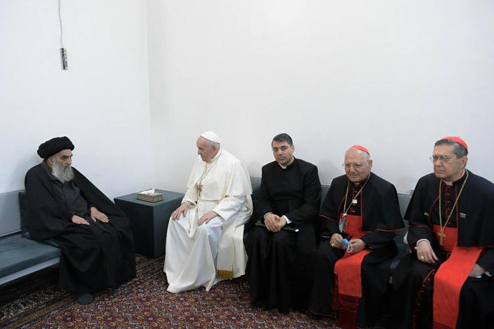 A photo released by the Grand Ayatollah Ali al-Sistani Office shows Shiite Muslim leader, Grand Ayatollah Ali al-Sistani, left, meeting Pope Francis, 2nd left, along with Christian priests in Najaf, Iraq, Saturday, March 6, 2021. Pope Francis arrived in Iraq on Friday to urge the country's dwindling number of Christians to stay put and help rebuild the country after years of war and persecution, brushing aside the coronavirus pandemic and security concerns to make his first-ever papal visit. (AP Photo/HO)