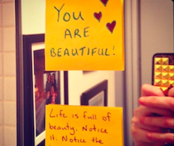 """Two post-it notes. One reads, """"You are beautiful"""" - with hearts drawn in the corner. The second one reads, """"Life is full of beauty. Notice it."""""""