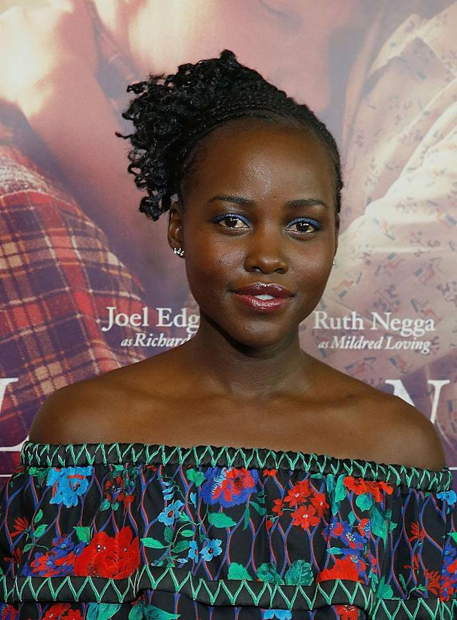 <p>At the New York premiere for <em>Loving</em>, Nyong'o wore a pretty side-braided puff. (Photo: Getty Images) </p>