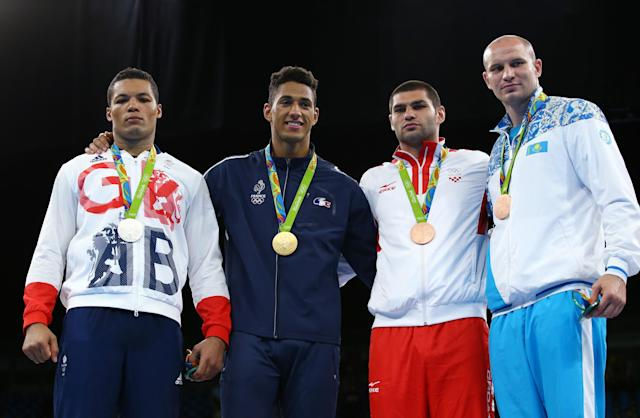 2016 Rio Olympics - Boxing - Victory Ceremony - Men's Super Heavy (+91kg) Victory Ceremony - Riocentro - Pavilion 6 - Rio de Janeiro, Brazil - 21/08/2016. (From L) Silver medallist Joseph Joyce (GBR) of Britain, gold medallist Tony Yoka (FRA) of France and bronze medallists Filip Hrgovic (CRO) of Croatia and Ivan Dychko (KAZ) of Kazakhstan pose with their medals. REUTERS/Peter Cziborra FOR EDITORIAL USE ONLY. NOT FOR SALE FOR MARKETING OR ADVERTISING CAMPAIGNS.