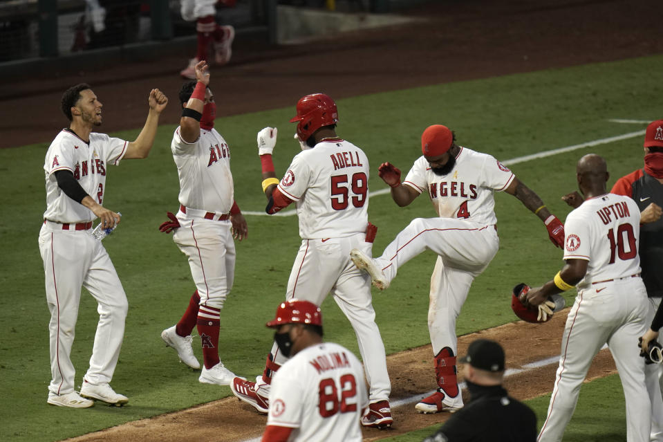 The Los Angeles Angels celebrate near home plate.