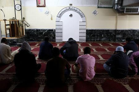 Muslims living in Greece attend Friday prayers at the Masjid Al-Salam makeshift mosque in Athens, Greece, February 3, 2017. REUTERS/Alkis Konstantinidis
