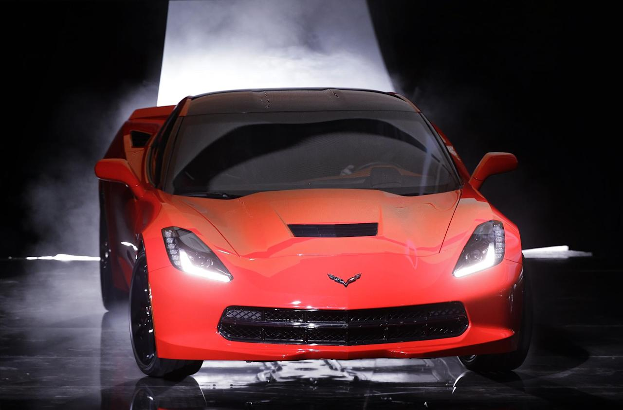 CORRECTS MONTH - The 2014 Chevrolet Corvette Stingray debuts in Detroit, Sunday, Jan. 13, 2013. The C7 Corvette debuted before the start of the media previews at the North American International Auto Show. (AP Photo/Paul Sancya)