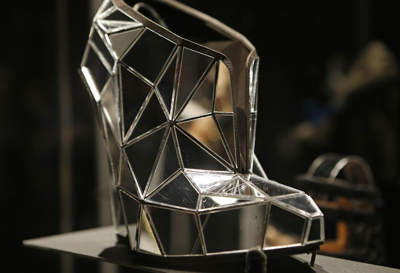 "This Feb. 11, 2013 photo shows a shoe, made of mirror fragments titled ""Invisible"", designed by Andreia Chaves, displayed at the ""Shoe Obsession"" exhibit at The Museum at the Fashion Institute of Technology Museum in New York. The exhibition, showing off 153 specimens, runs through April 13. (AP Photo/Kathy Willens)"