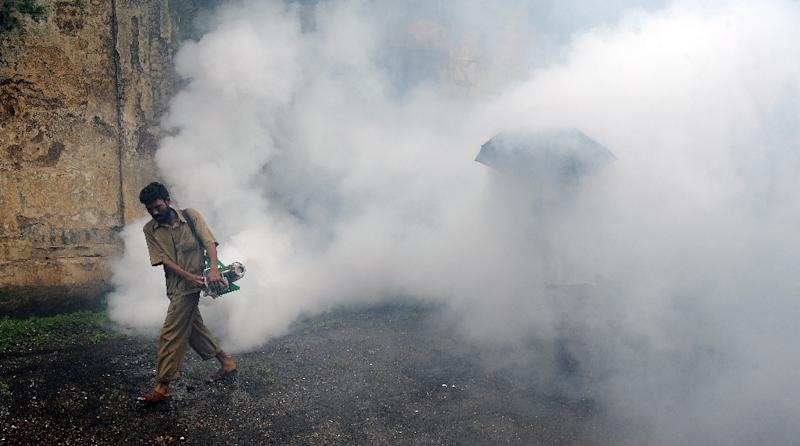 A municipal worker uses an anti-malaria fumigation spray machine in Mumbai, India (AFP Photo/Indranil Mukherjee)