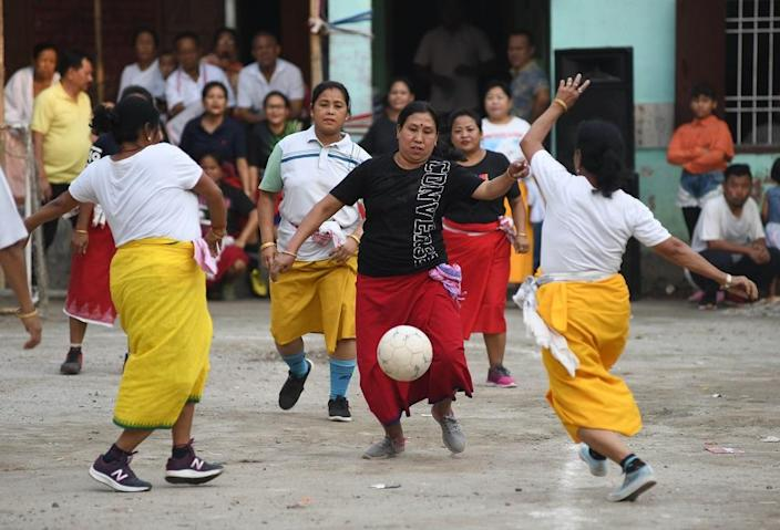File photo: Indian women play football during an event to mark the Manipuri new year celebrations as part of the Cheiraoba Festival in Guwahati on April 19, 2019. (Photo by BIJU BORO/AFP via Getty Images)