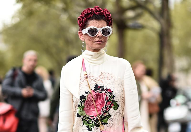 PARIS, FRANCE - SEPTEMBER 29: A guest is seen wearing a white with a rose Valentino dress and floral headpiece outside the Valentino show during Paris Fashion Week SS20 on September 29, 2019 in Paris, France. (Photo by Daniel Zuchnik/Getty Images)