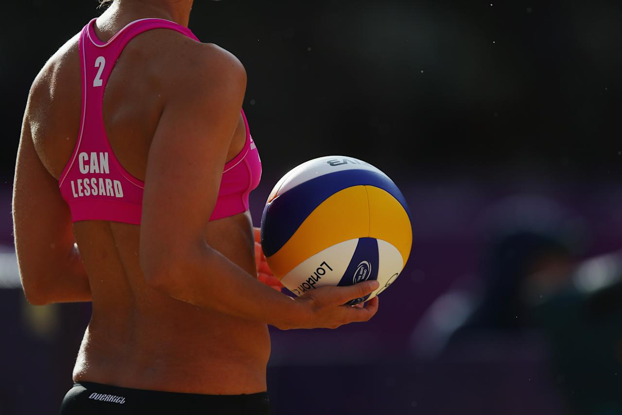LONDON, ENGLAND - JULY 29: Marie-Andree Lessard of Canada prepares to serve during the Women's Beach Volleyball Preliminary match between Great Britain and Canada on Day 2 of the London 2012 Olympic Games at Horse Guards Parade on July 29, 2012 in London, England. (Photo by Ryan Pierse/Getty Images)