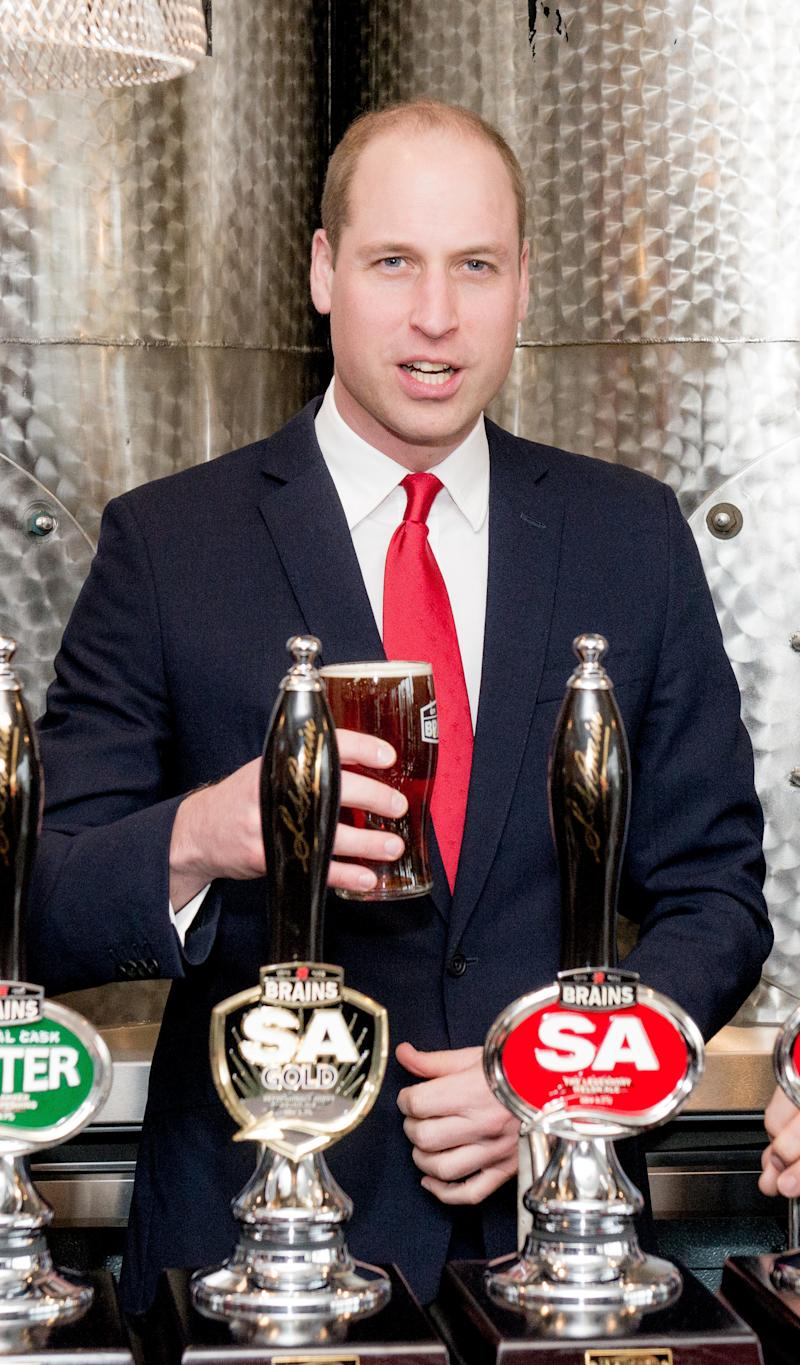 Prince William pulls a pint while officially opening Brains Brewery, before attending the Wales vs Ireland Six Nations Match on March 16 in Cardiff, Wales. (Richard Stonehouse via Getty Images)