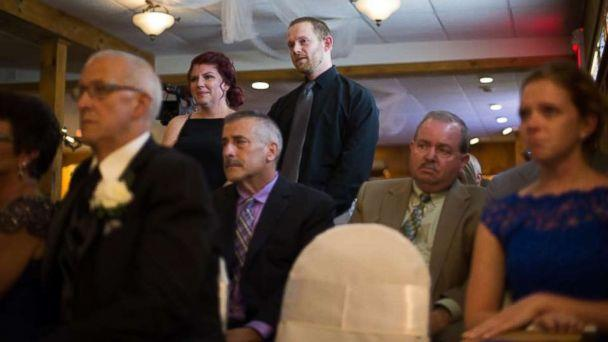 PHOTO: Casey Bender seen with her husband ,Tyler Bender, at the wedding ceremony of her son's father. (The Wise Image)