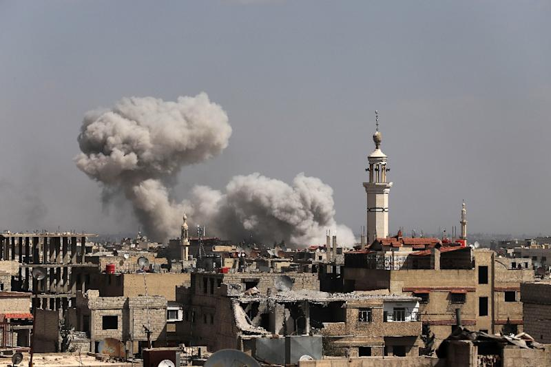 Smoke billows following Syrian government bombardment of rebel-controlled Kafr Batna in the besieged Eastern Ghouta region on the outskirts of the capital Damascus on March 11, 2018