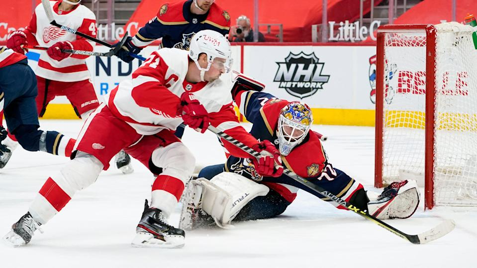 Panthers goaltender Sergei Bobrovsky defends Red Wings center Dylan Larkin in the second period of the Wings' 2-1 win on Saturday, Feb. 20, 2021, at Little Caesars Arena.