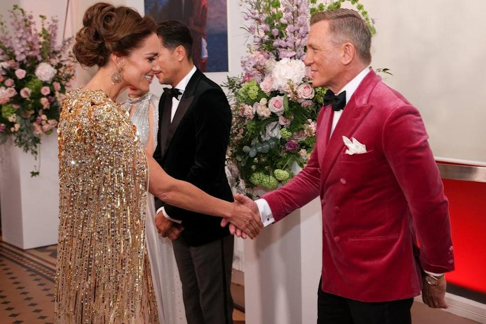 The Duchess of Cambridge is greeted by Daniel Craig upon her arrival for the World Premiere of No Time To Die (PA)