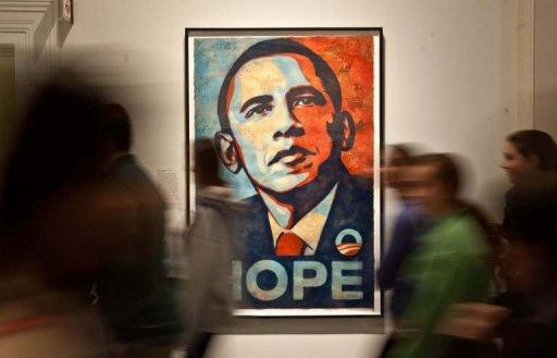 <p>Visitors walk past Shepard Fairey's portrait of US President Barack Obama at the National Portrait Gallery in Washington on January 19, 2013. Obama will Sunday be sworn in to shoulder the power and burden of the US presidency for a second term, launching two days of inaugural rituals darkened by domestic discord and crises abroad.</p>