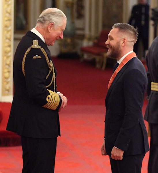 The Prince of Wales chats to Tom Hardy after presenting his CBE (Yui Mok/PA)