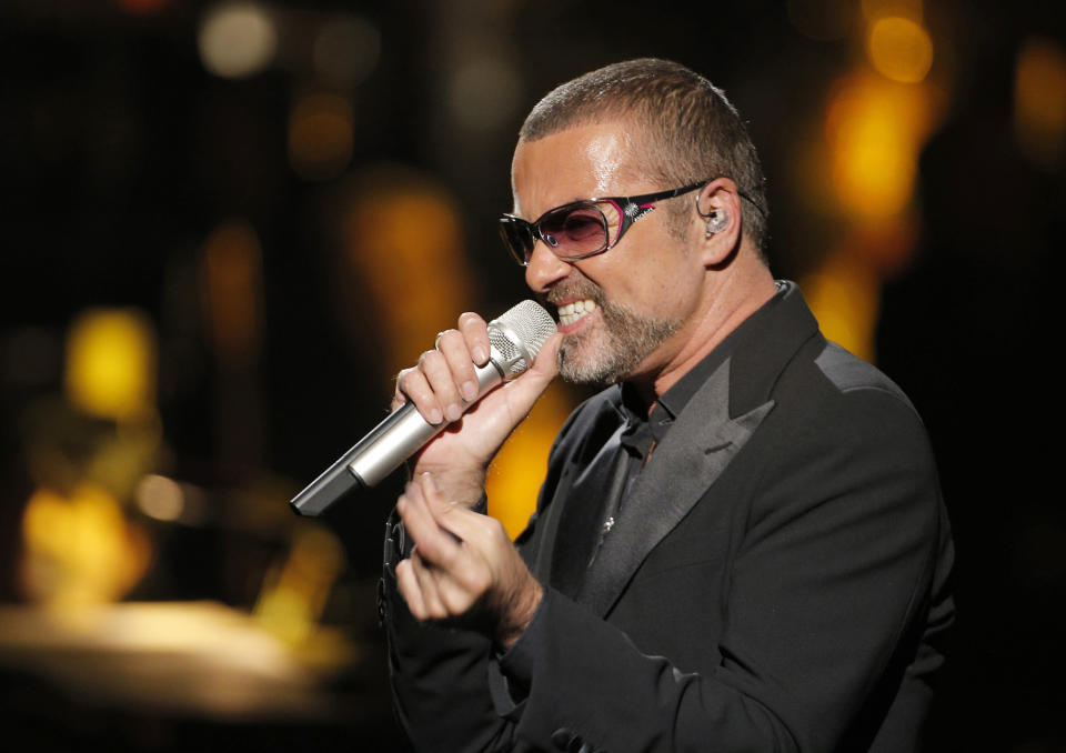 """FILE - In this Sept. 9, 2012 file photo, British singer George Michael in concert to raise money for AIDS charity Sidaction, in Paris, France. George Michael's spokeswoman says the singer is """"resting"""" after receiving hospital treatment for an undisclosed ailment. The Grammy Awards announced Wednesday Feb. 8, 2017, that Sunday's show will include tribute performances in honor of Prince and George Michael. Both stars died last year. (AP Photo/Francois Mori, File)"""
