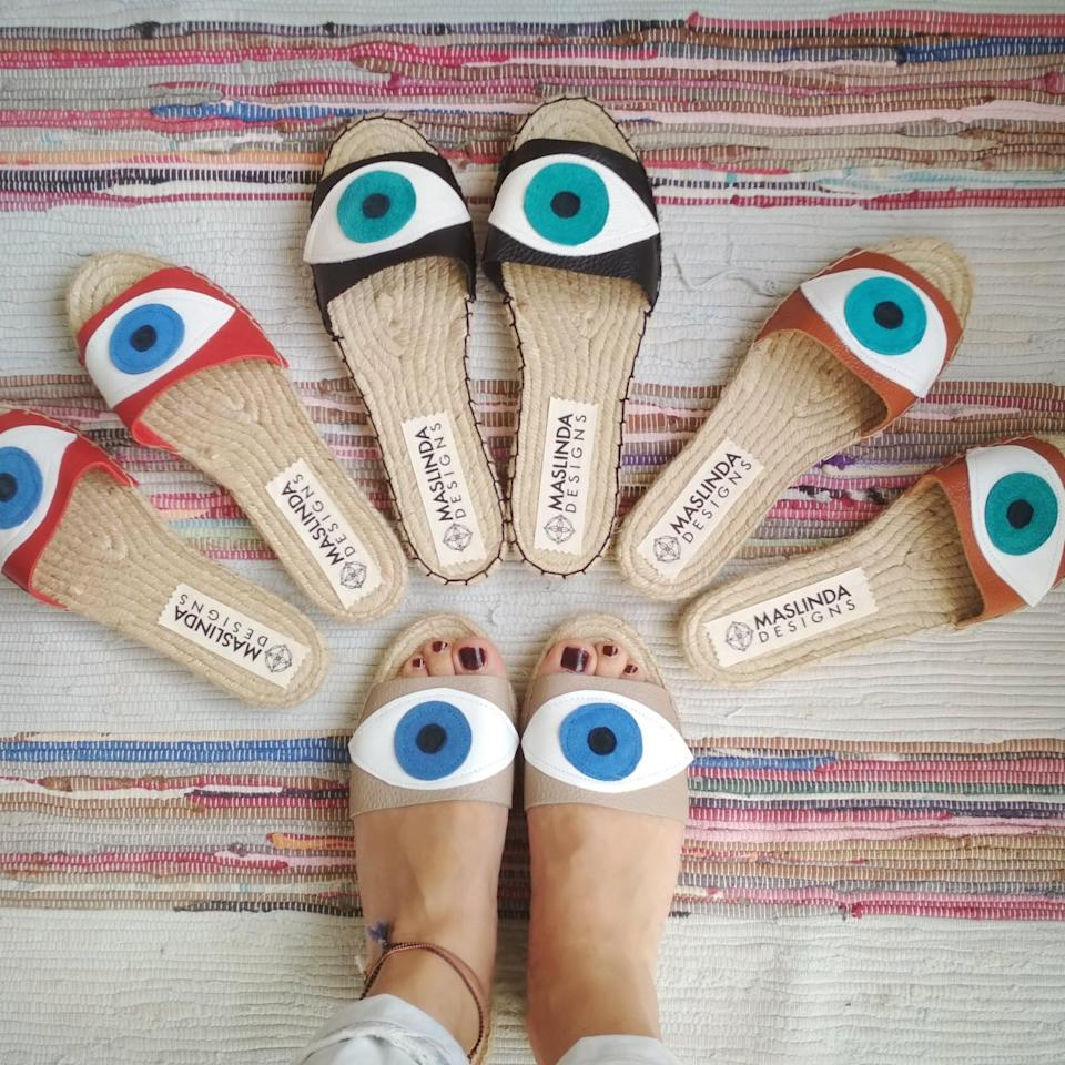 "<br> <br> <strong>MasLinda</strong> Evil Eye Leather Espadrilles Slides, $, available at <a href=""https://go.skimresources.com/?id=30283X879131&url=https%3A%2F%2Fwww.etsy.com%2Flisting%2F583738484%2Fslides-sandals-with-evil-eye-leather"" rel=""nofollow noopener"" target=""_blank"" data-ylk=""slk:Etsy"" class=""link rapid-noclick-resp"">Etsy</a>"