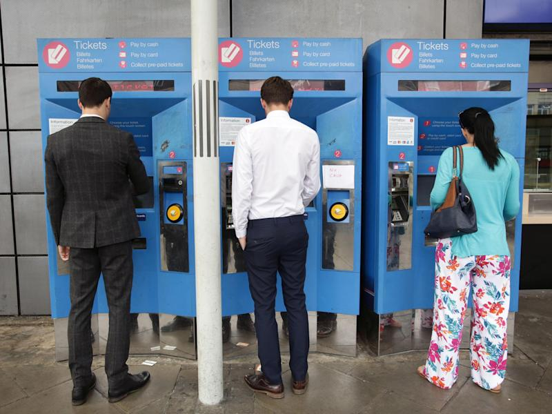 Commuters buy train tickets from machines at Finsbury Park station in north London: PA