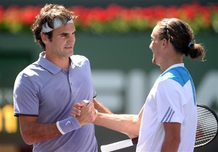 Mar 15, 2014; Indian Wells, CA, USA; Roger Federer (SUI), left, shakes hands with Alexandr Dolgopolov (UKR) after their semifinal match at the BNP Paribas Open at Indian Wells Tennis Garden. Federer won 6-3, 6-1. Mandatory Credit: Jayne Kamin-Oncea-USA TODAY Sports