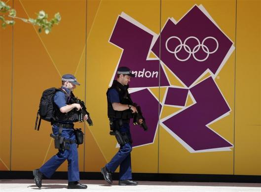 Armed police officers patrol the Athletes' Village at the Olympic Park in London, July 19, 2012.