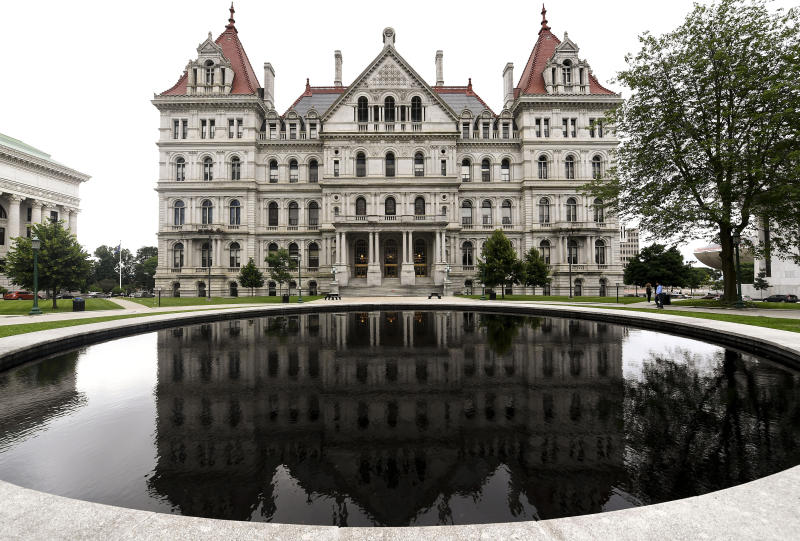 Exterior view of the New York state Capitol Wednesday, June 19, 2019, in Albany, N.Y.  Legal marijuana, new rights for farmworkers and a stronger legal standard for sexual harassment are among the final issues being debated by New York state lawmakers Wednesday, the day they are scheduled to adjourn their 2019 session. (AP Photo/Hans Pennink)
