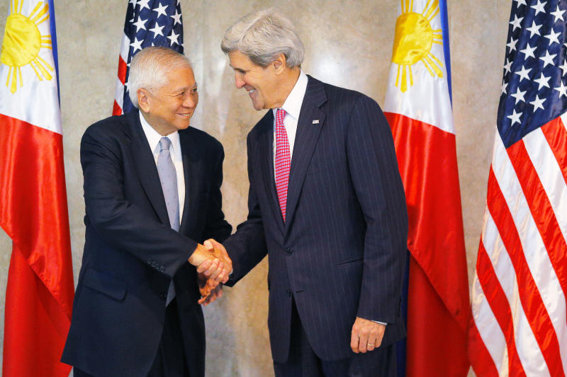 U.S. Secretary of State John Kerry, right, is greeted by Philippine Foreign Secretary Albert del Rosario for a meeting in Manila, Philippines Tuesday, Dec. 17, 2013. Kerry is in the Philippines to show American backing for its longtime ally and inspect typhoon recovery efforts. (AP Photo/Brian Snyder, Pool)