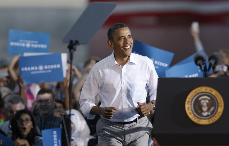 President Barack Obama arrives at a campaign stop at RiverLoop Amphitheatre at the Waterloo Center for the Arts, Tuesday, Aug. 14, 2012, in Waterloo, Iowa. The president is on a three-day campaign bus tour through the state. (AP Photo/Charlie Neibergall)