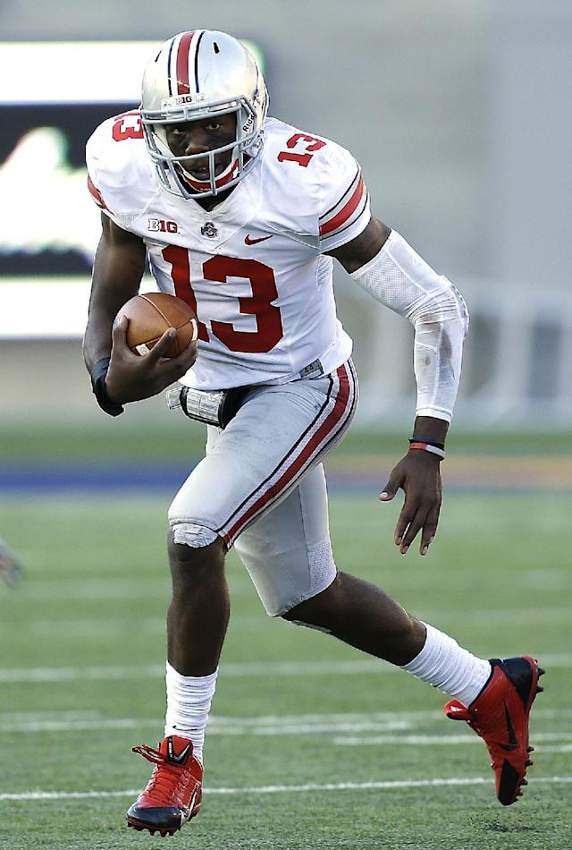 Ohio State quarterback Kenny Guiton scrambles against California during the second half of an NCAA college football game, Saturday, Sept. 14, 2013, in Berkeley, Calif. (AP Photo/Ben Margot)