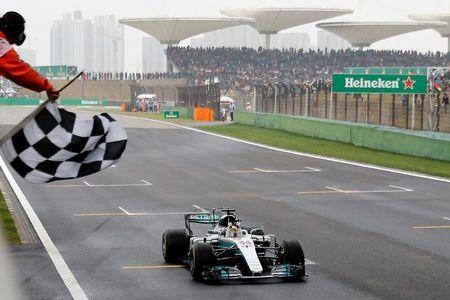 Mercedes driver Lewis Hamilton of Britain gets the checkered flag to win the Chinese Formula One Grand Prix at the Shanghai International Circuit in Shanghai, China, Sunday, April 9, 2017. REUTERS/Andy Wong/Pool -