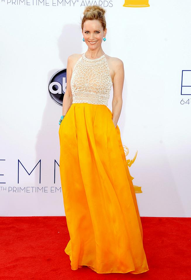 "Leslie Mann Grade: B- Actress Leslie Mann, the wife of ""Girls"" executive producer Judd Apatow, stood out in a Naeem Khan dress featuring an intricate beaded top and a flowing marigold-colored skirt. She paired the bright frock with turquoise pieces courtesy of Lorraine Schwartz."