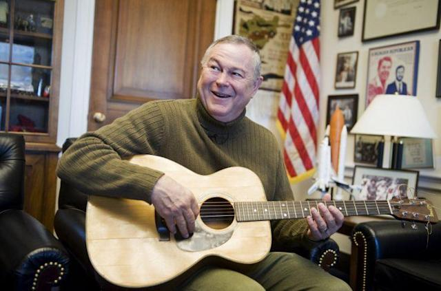 "Rohrabacher sings a song he wrote entitled ""God Bless Our Freedom"" while giving a tour of his Rayburn Building office to Roll Call. (Photo: Tom Williams/Roll Call)"