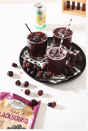 """<p>Combine 1 oz. of cranberry and 2 oz. of grape juice. Drizzle 3.5 oz of Sprouts Lemon Sparkling Water on top and stir. Then, add some frozen blackberries for garnish and enjoy. </p><p><em>Recipe from <a href=""""https://www.thespeckledpalate.com/fizzy-potion-halloween-punch/"""" rel=""""nofollow noopener"""" target=""""_blank"""" data-ylk=""""slk:The Speckled Plate"""" class=""""link rapid-noclick-resp"""">The Speckled Plate</a>. </em></p>"""