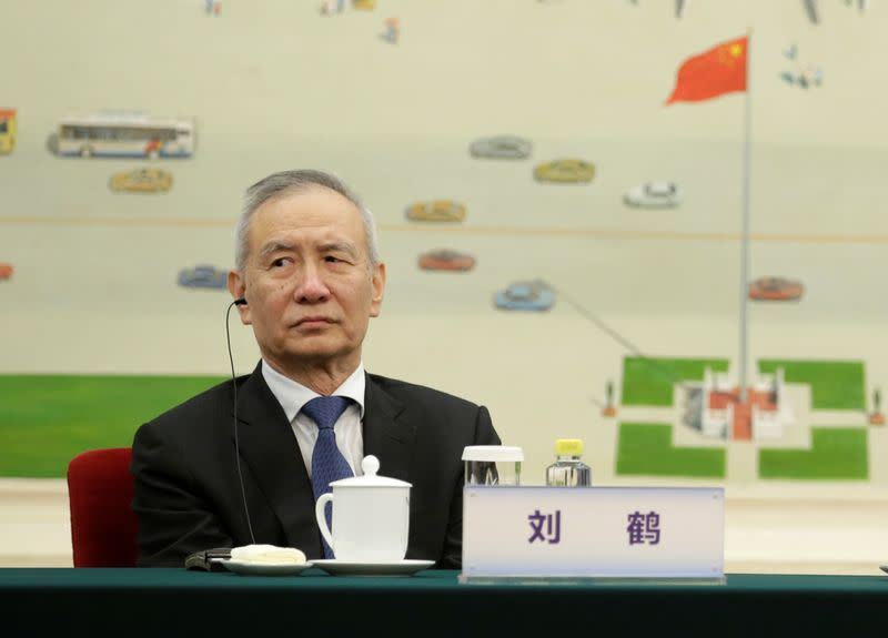 Chinese Vice Premier Liu He attends a meeting with delegates from the 2019 New Economy Forum in Beijing