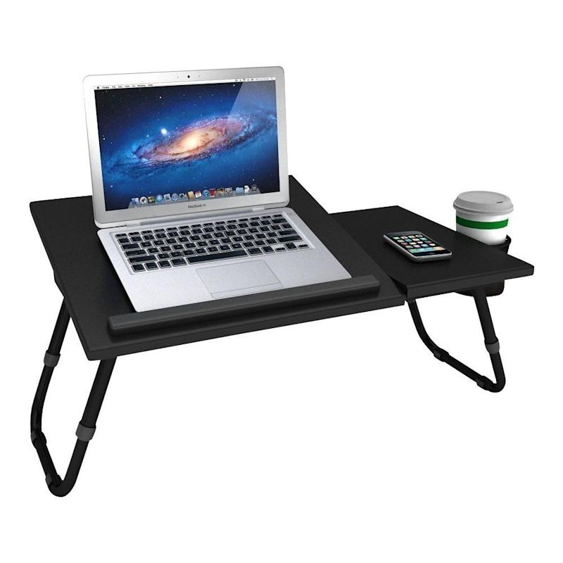 "Type the day away with this laptop tray. <a href=""https://fave.co/33KZz2V"" target=""_blank"" rel=""noopener noreferrer"">Find it for $36 at Best Buy</a>.&nbsp;"