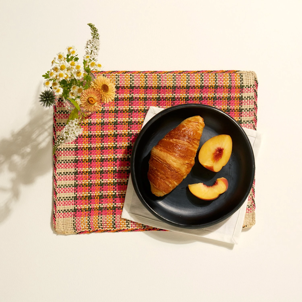"""Liven up her otherwise neutral tablescape with these handcrafted placemats made by artisans in Colombia. <br><br><strong>Ames</strong> Jipi Plate Mat (Set Of 6), $, available at <a href=""""https://go.skimresources.com/?id=30283X879131&url=https%3A%2F%2Fwww.goodeeworld.com%2Fcollections%2Fkitchen%2Fproducts%2Fjipi-plate-mat-1"""" rel=""""nofollow noopener"""" target=""""_blank"""" data-ylk=""""slk:Goodee"""" class=""""link rapid-noclick-resp"""">Goodee</a>"""