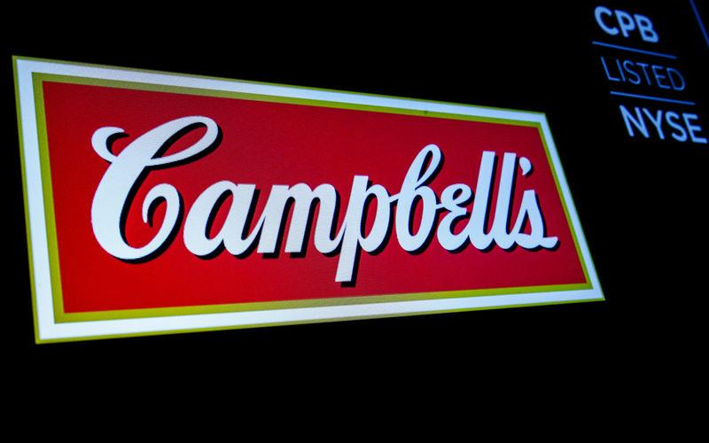 The logo and ticker for Campbell Soup Co. are displayed on a screen on the floor of the NYSE in New York