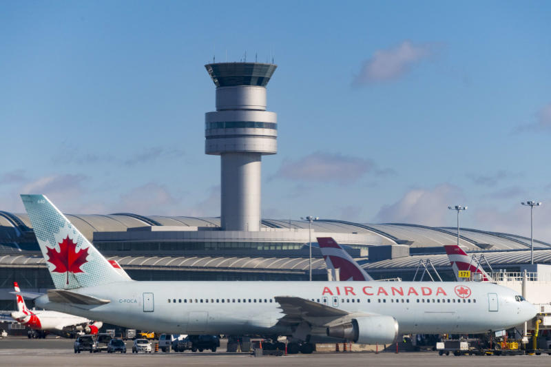 TORONTO, ONTARIO, CANADA - 2017/03/03: Air Canada plane in Pearson International Airport with the Control Tower in the background. (Photo by Roberto Machado Noa/LightRocket via Getty Images)