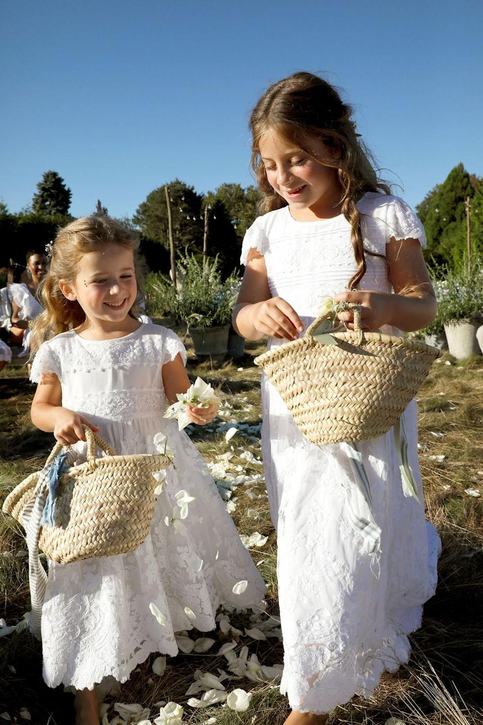 """""""Flower girls, sisters Stella and Scarlett. This was their first wedding experience,"""" Dean says."""
